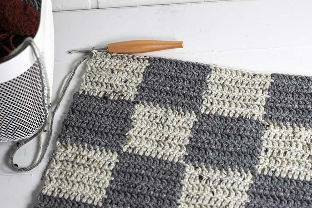 This giant crochet checkerboard pattern creates a rug size checkerboard and game pieces. This free crochet pattern uses basic stitches.