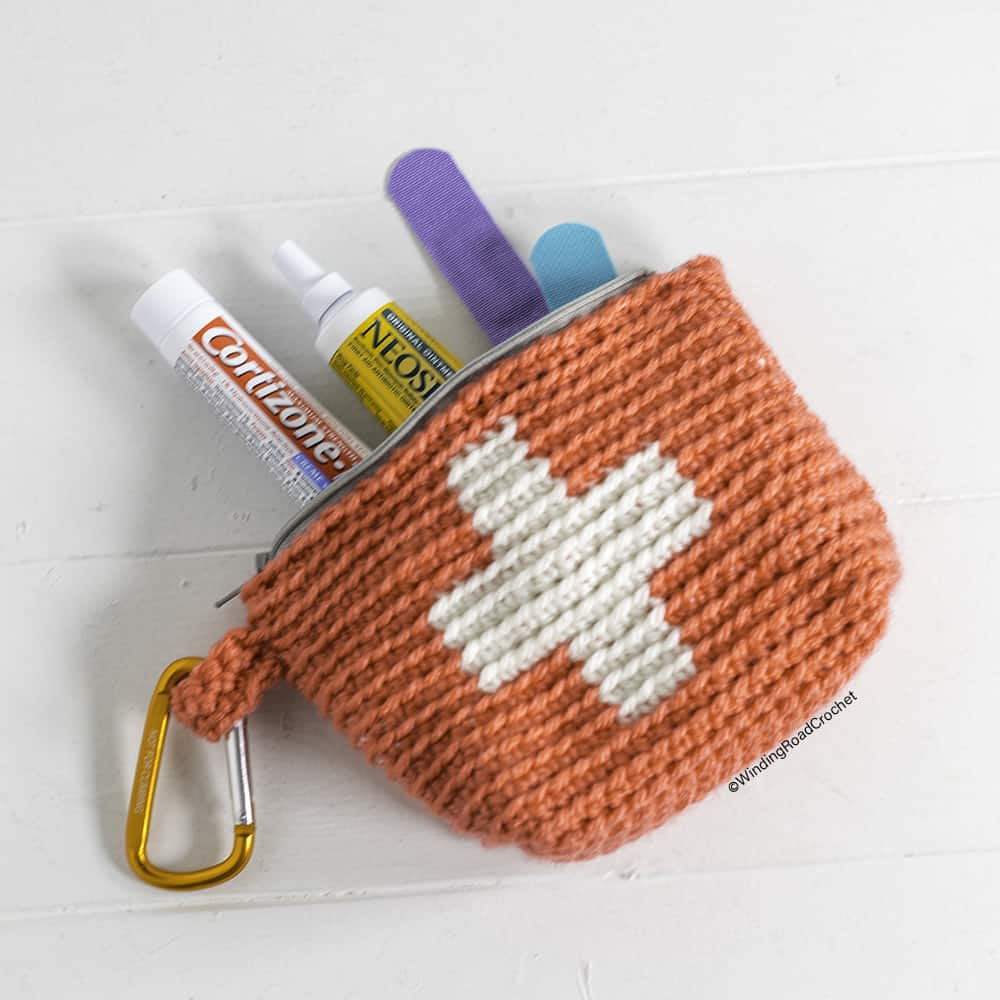 Whip up a quick and easy first aid crochet pouch. This pattern makes a great gift for new moms, for college kids, and for men. Video Tutorial.