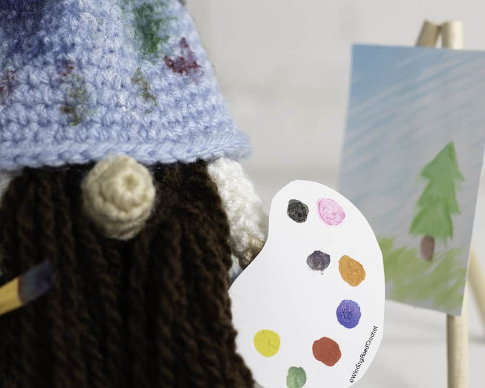 This crochet artist gnome will be a great addition to your collection. Just follow the free crochet pattern and video tutorials to make it.