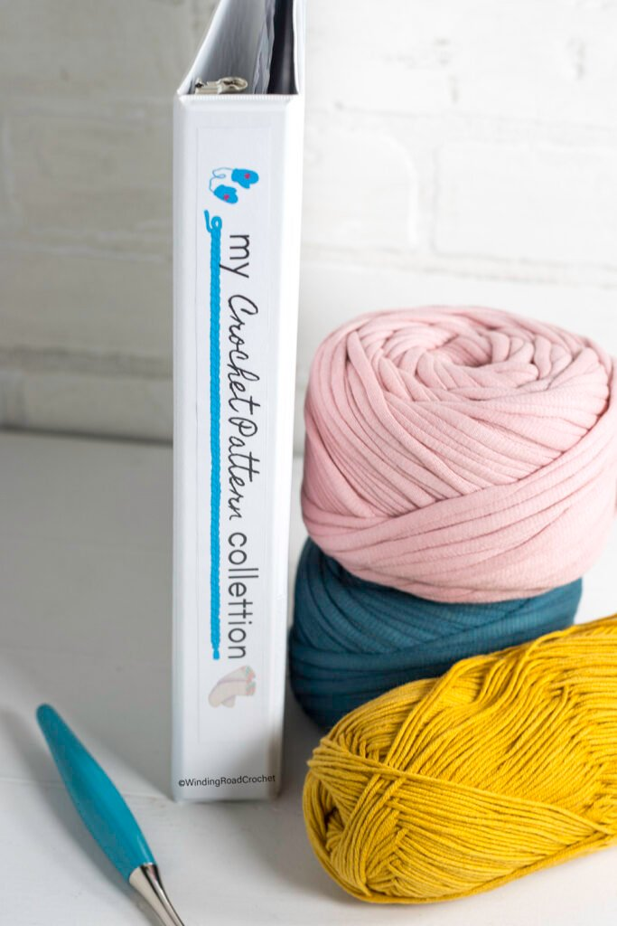 Keep your patterns organized with these free printable crochet pattern binder pages. Includes 13 category pages, cover, and binder spine.