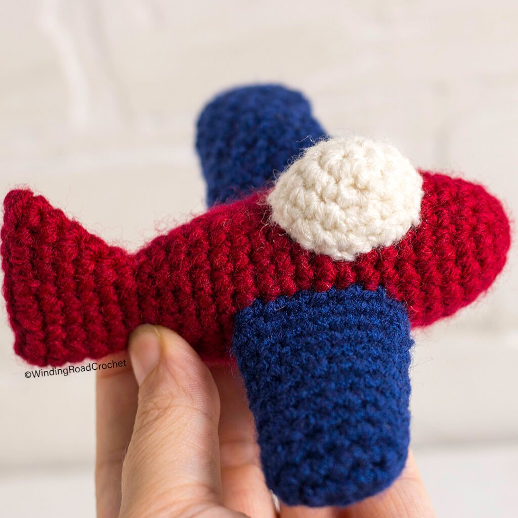 Make an Airplane crochet lovey for a baby shower gift. This free crochet pattern will walk you through how to make this cute crochet lovey.