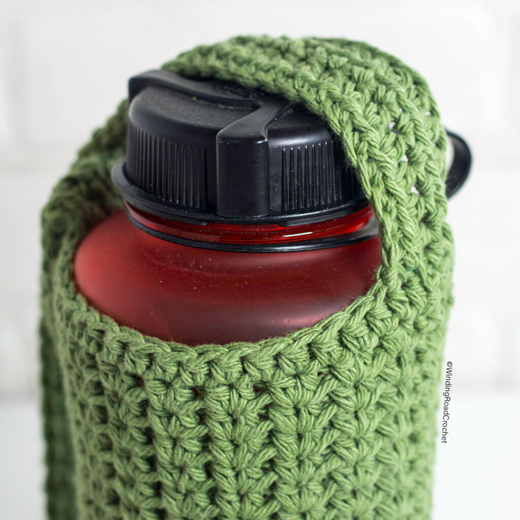Use this crochet water bottle holder to keep your water with you. Free crochet pattern and video that is adjustable to fit any water bottle.
