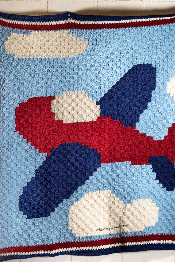 Use this printable graph to create a corner to corner crochet airplane baby blanket. There are helpful video tutorials and a border pattern.