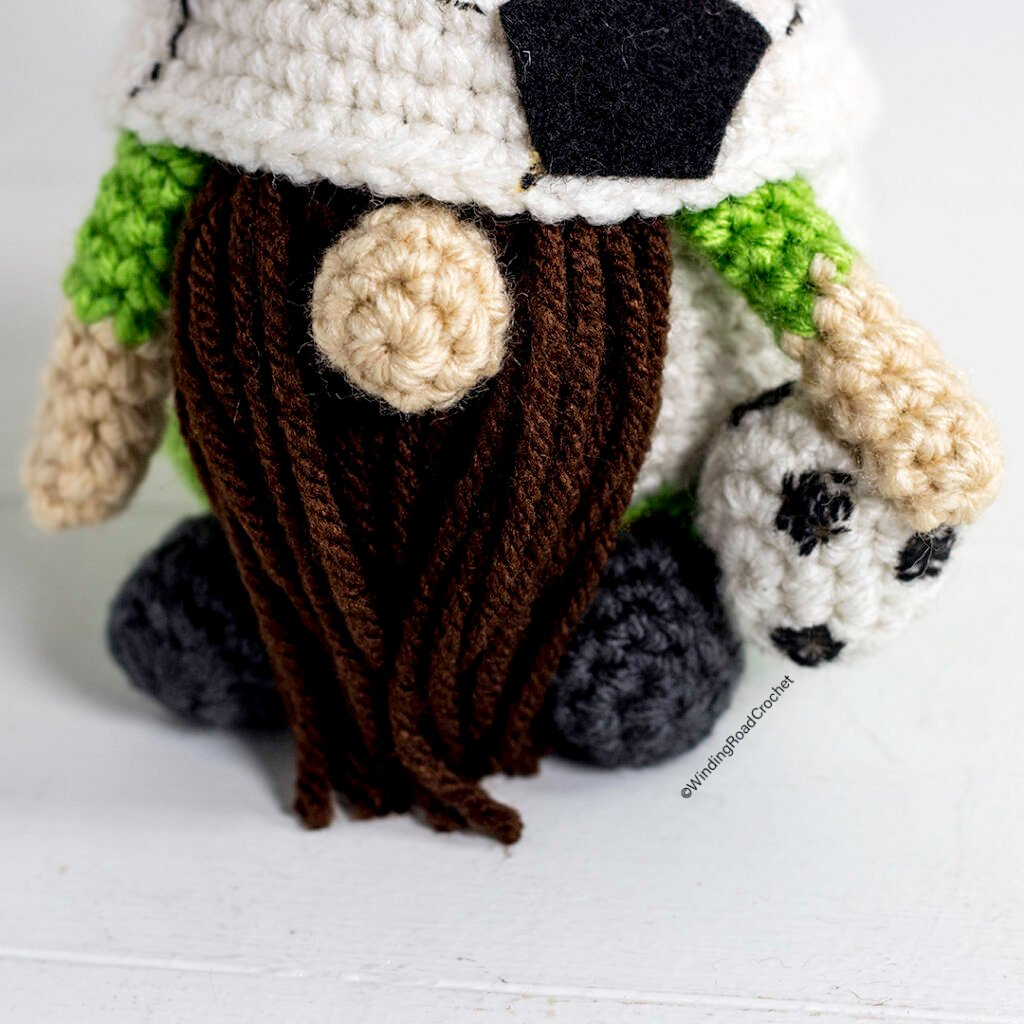 A crochet soccer gnome makes a great gift for a sports fan. Free crochet pattern for a cute sports gnome with helpful videos.
