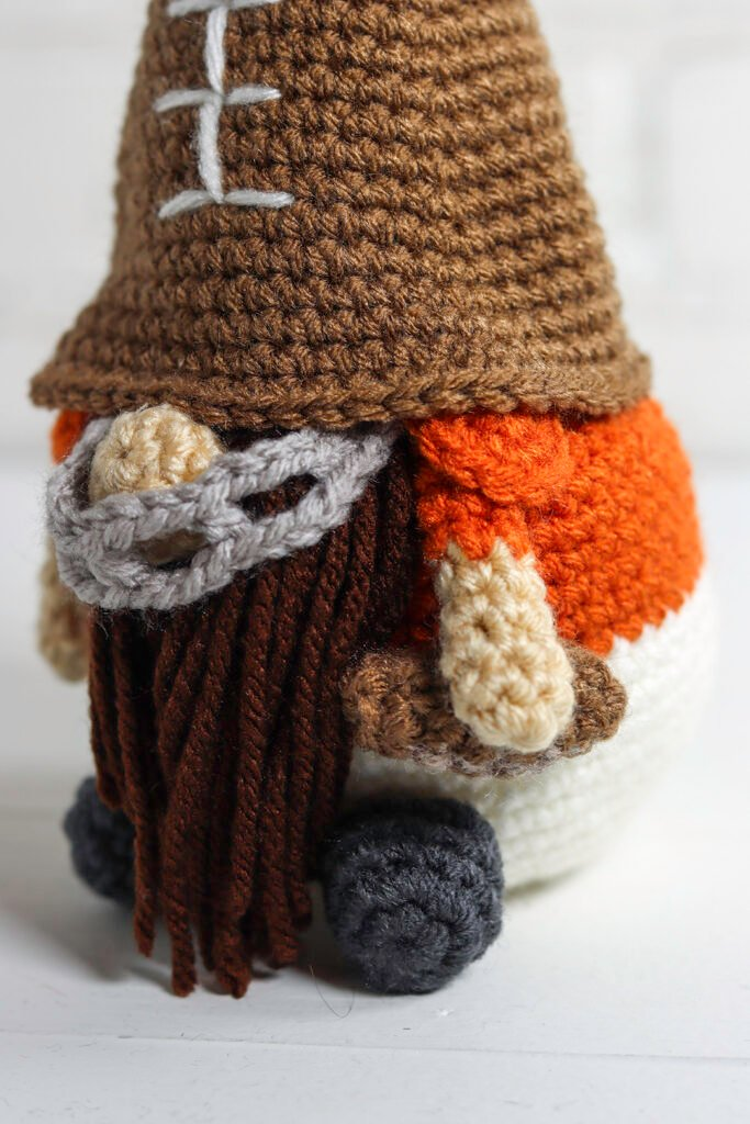 A crochet football gnome makes a great gift for a sports fan. Free crochet pattern for a cute sports gnome with helpful videos.