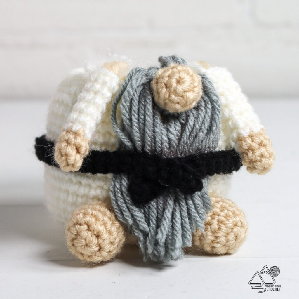 A crochet karate gnome makes a great gift for a sports fan. Free crochet pattern for a cute sports gnome with helpful videos.