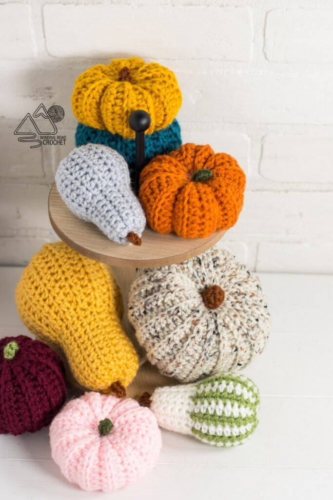 Decorate for fall with a small crochet gourd and small crochet pumpkins. Use up your scrap yarn with these free crochet patterns.