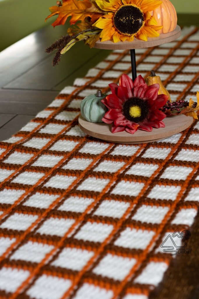 Decorate for the holidays with is free crochet pattern for a tartan plaid table runner. Tartan plaid can be made with any color combination.