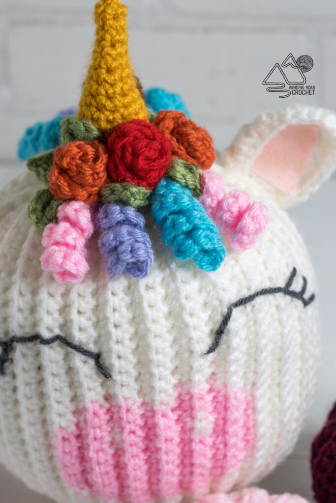 Free crochet pattern for this adorable crochet unicorn pumpkin. This easy crochet pattern works up quickly and is fun for Halloween.